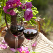 Glasses of wine and rose — Stockfoto #5974096