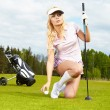 Woman and golf — Stock Photo