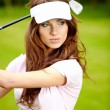 Young woman playing golf in a country club — Stock Photo #6252630