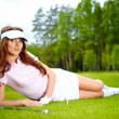 Young woman playing golf in a country club — Stock Photo #6252650