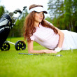 Young woman playing golf in a country club — Stock Photo