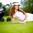 Young woman playing golf in a country club — Stock Photo #6252669