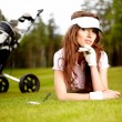 Young woman playing golf in a country club — Stock Photo #6252682