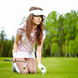 Young woman playing golf in a country club — Stock Photo #6252708