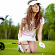 Young woman playing golf in a country club — Stock Photo #6252722