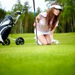 A pretty woman golfer - Stock Photo