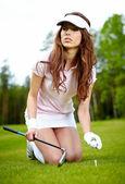 A pretty woman golfer — Stock Photo