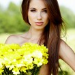 Closeup portrait of cute young girl with yellow flowers smiling — Foto de Stock