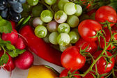 Photo of a table top full of fresh vegetables, fruit, and other — Stock Photo