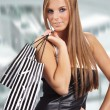 Beautiful shopping woman at  mall — Stock Photo