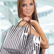 Beautiful shopping woman at  mall - Stockfoto
