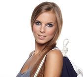 Beautiful sexy woman wearing sailor striped dress posing — Stock Photo