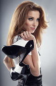 Beautiful woman after party holding shoes . Girl and shoe — Stock Photo