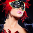 Stock Photo: Beautiful young womin carnival mask and feather boa.