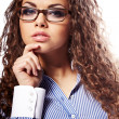 Portrait of a successful businesswoman in glasses  a white backg - Stockfoto