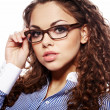 Portrait of a successful businesswoman in glasses  a white backg - Foto Stock