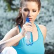 Young woman drinking water at outdoors workout — Stock Photo #6390266