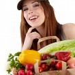 Healthy lifestyle - cheerful woman with fruit shopping paper bag — Stock Photo