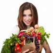 Woman holding a bag full of healthy food. shopping . — Stock Photo #6421876