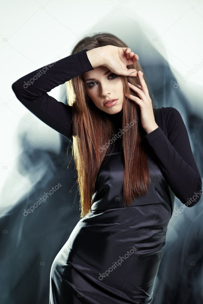Young woman wearing gorgeous black dress  — Stock Photo #6421141