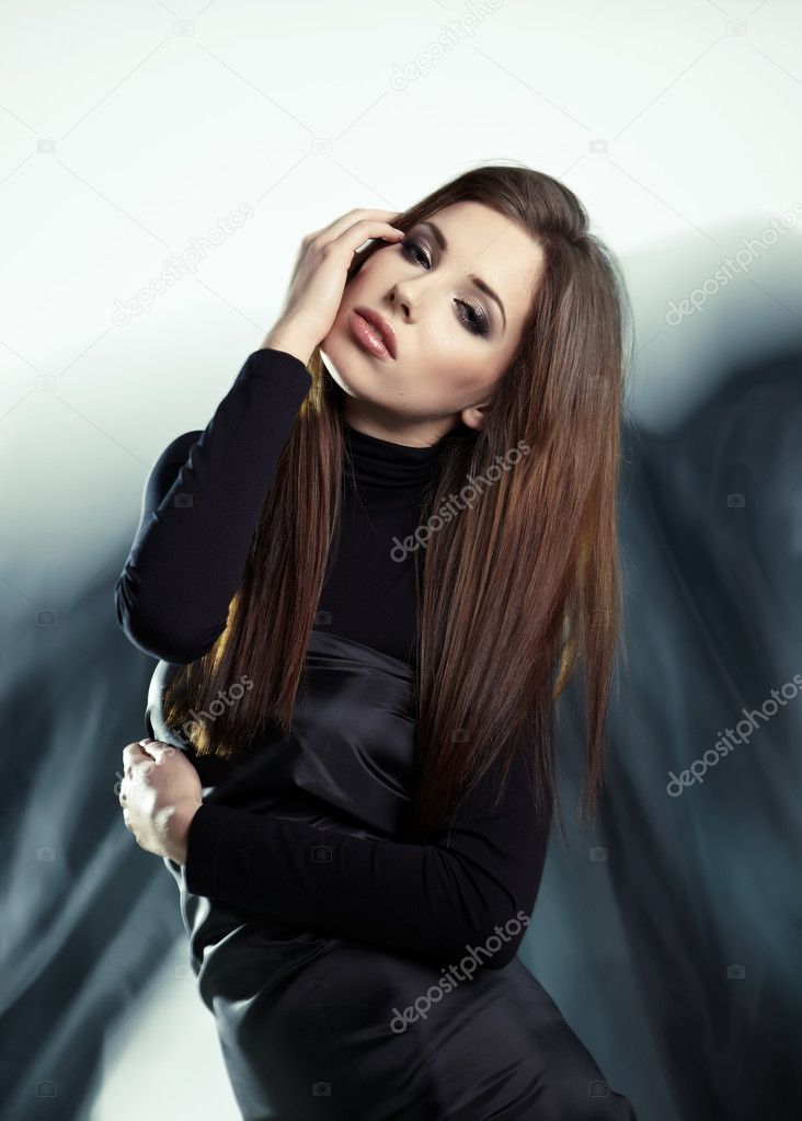 Young woman wearing gorgeous black dress  — Stock Photo #6421191