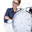 Young businesswoman with a big clock — Stock fotografie