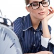 Young businesswoman with a big clock — Stock Photo
