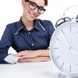 Young businesswoman with a big clock — Stock Photo #6449195