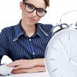Young businesswoman with a big clock — Stock Photo #6449214