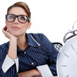 Young businesswoman with a big clock — Stock Photo #6449284