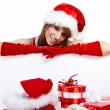 Sexy christmas girl smiles and holding a gift in packing — Stock Photo #6449801