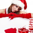 Sexy christmas girl smiles and holding a gift in packing — Stock Photo #6449892