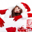 Sexy christmas girl smiles and holding a gift in  packing - Stock Photo