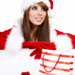 Sexy christmas girl smiles and holding a gift in packing — Stock Photo