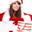 Sexy christmas girl smiles and holding gift in packing — Stock Photo #6449945