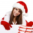 Sexy christmas girl smiles and holding a gift in packing — Stock Photo #6449965