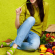 Portrait of a girl holding in hands full of different fruits and - Foto Stock