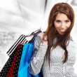 Beautiful shopping woman at a draw mall - Foto de Stock  
