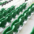 Safety  plastic armchairs on stadium tribune - Stock Photo