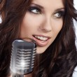Pop female singer with the retro microphone — Stock Photo #6472637