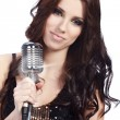 Pop female singer with the retro microphone — Stock Photo #6472780