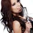 Pop female singer with the retro microphone — Stock Photo #6473100