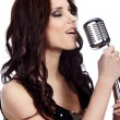 Pop female singer with the retro microphone — Stock Photo
