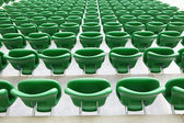 Safety plastic armchairs on stadium tribune — Stock Photo