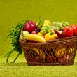 Basket full of fresh produce. green background - Stock Photo