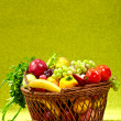 Basket full of fresh produce. green background — Stock Photo #6510034