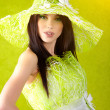 Photo: Beautiful spring woman portrait. green concept