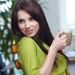 Beautiful smiling business woman sitting and relaxing in the off — Stock Photo