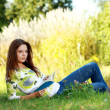 Young  woman studying in summer park — Stock Photo