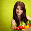 Portrait of a girl holding in hands full of different fruits and — Stock Photo